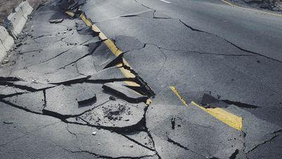 cracks-in-sidewalk-road-earthquake
