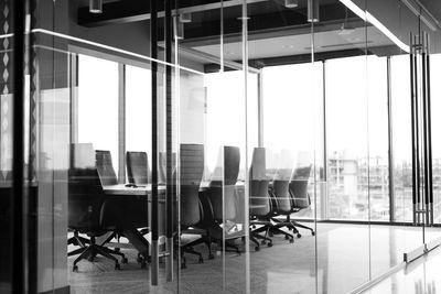 corporate-board-room-tables-chairs-windows